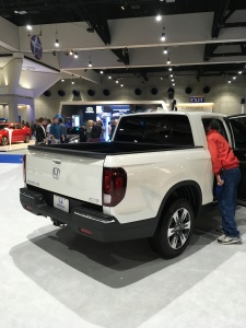 This is the rear of a new Honda Ridgeline. I'd get this for light to medium duty truck use. The Chevy Colorado and Toyota Tacoma are also better alternatives to the big boys in my opinion. But of course the Honda Ridgeline would be my first pick.